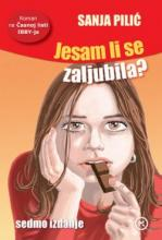 A girl with the long brown hair is thoughtfully nibbling a piece of chocolate.