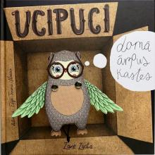 Ucipuci the Owl is looking out of the box